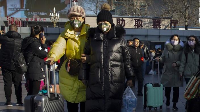 China: Menschen schützen sich vor dem Coronavirus