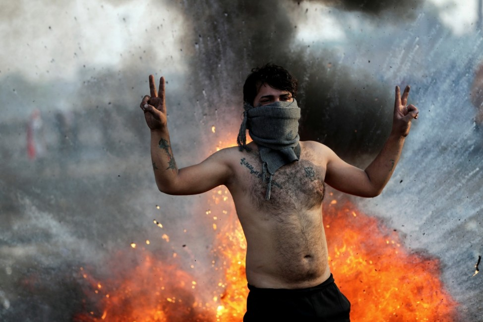 An Iraqi demonstrator gestures during ongoing anti-government protests in Baghdad