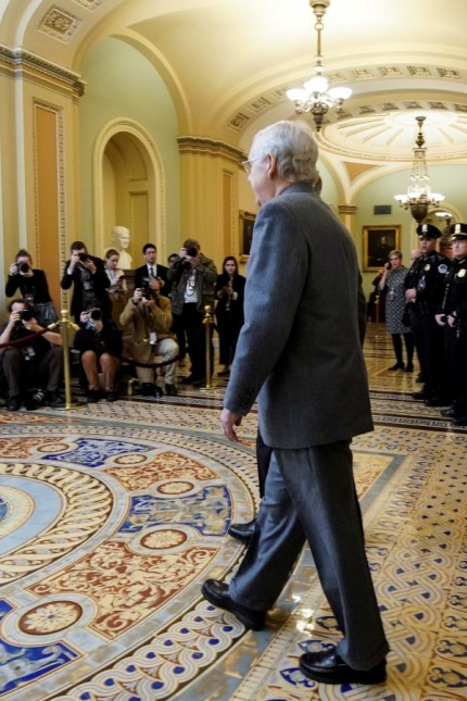 FILE PHOTO: Senate Majority Leader McConnell and Senator Cornyn arrive for the beginning of the Trump impeachment trial in Washington