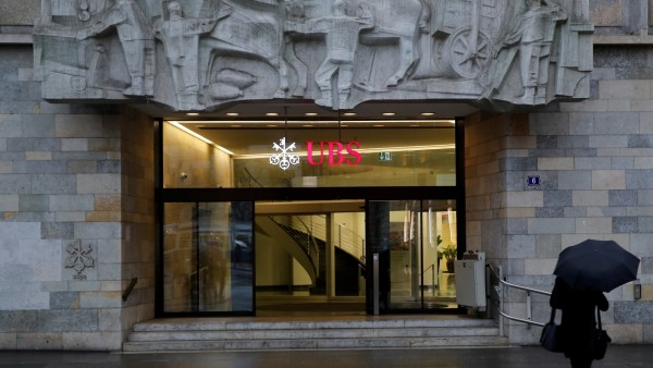 FILE PHOTO: The logo of Swiss bank UBS is seen at a branch office in Zurich
