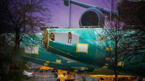 The end of two Boeing 737 Max fuselages are seen parked outside the company's production facility in Renton