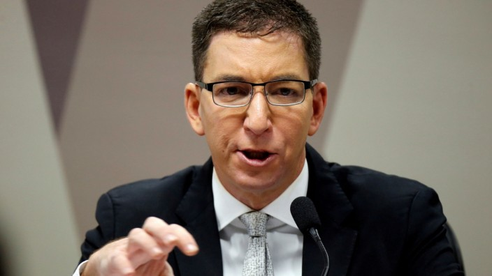 FILE PHOTO: Author and journalist Glenn Greenwald speaks during a meeting at Commission of Constitution and Justice in the Brazilian Federal Senate in Brasilia