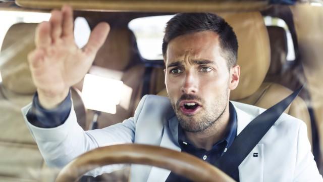Ranting businessman driving in his car model released Symbolfoto PUBLICATIONxINxGERxSUIxAUTxHUNxONL