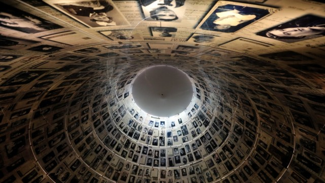 FILE PHOTO: A view from below shows pictures of Jews killed in the Holocaust displayed at the Hall of Names in the Holocaust History Museum at the Yad Vashem World Holocaust Remembrance Center in Jerusalem