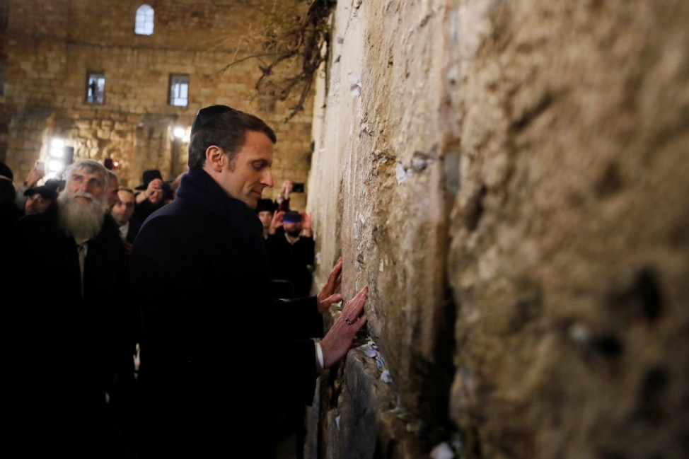 FILE PHOTO: French President Macron stands by the Western Wall, the holiest site where Jews can pray in Jerusalem's old city, during a visit in Jerusalem
