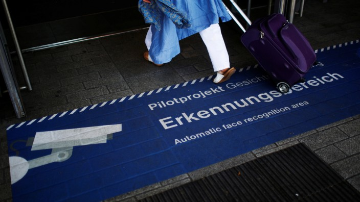 A sign marks a new facial recognition technology at the train station Suedkreuz in Berlin