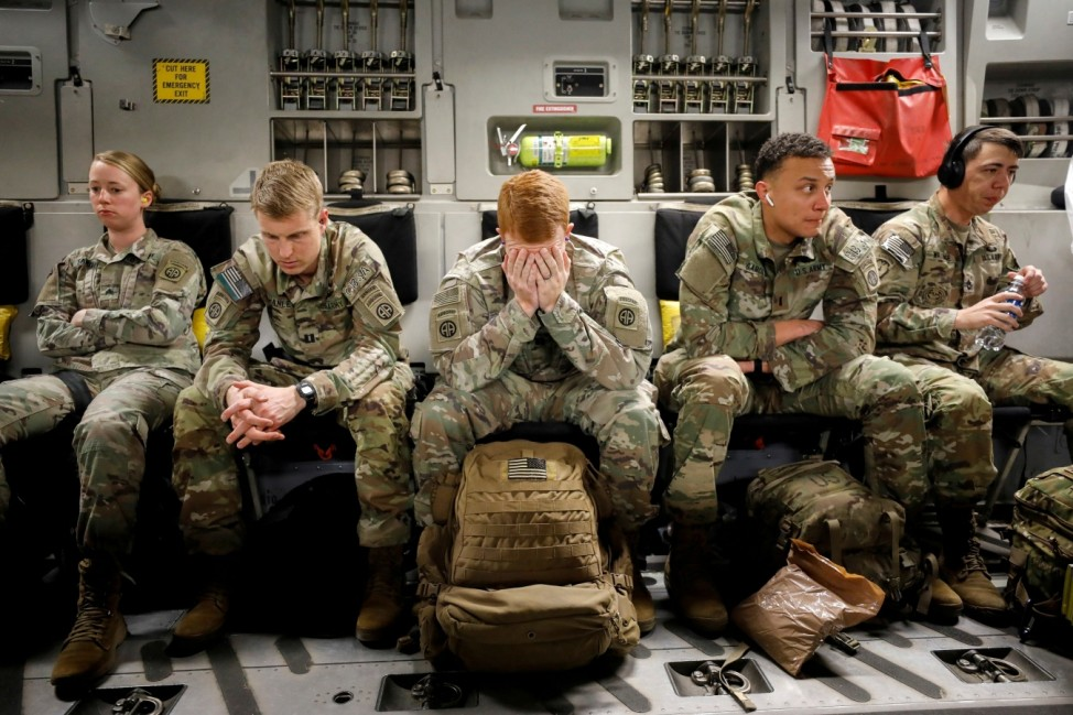 Paratroopers wait in the hold of a C-17 plane near the end of a long flight to Colombia to participate in a multinational exercise, in the air near Tolemaida Air Base
