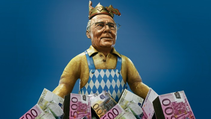A papier mache caricature depicting former international Beckenbauer is pictured during preparations for the upcoming Rose Monday carnival parade in Mainz; Collage WM 2006
