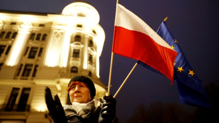 FILE PHOTO: People protest against judiciary reform in Warsaw
