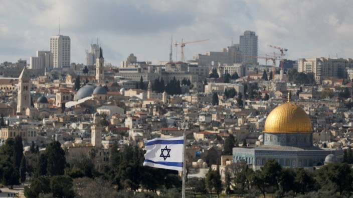 An Israeli flag is seen near the Dome of the Rock, located in Jerusalem's Old City on the compound known to Muslims as Noble Sanctuary and to Jews as Temple Mount