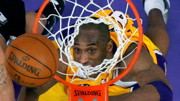 FILE PHOTO: Los Angeles Lakers Kobe Bryant eyes a rebound against the San Antonio Spurs during their NBA basketball game in Los Angeles