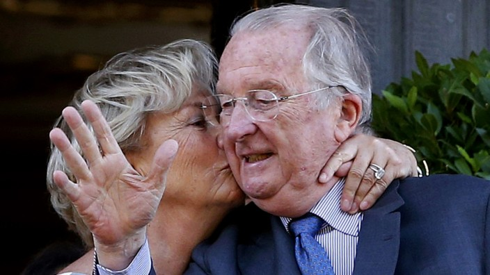 Belgium's King Albert II is kissed by Queen Paola on the balcony of city hall during a visiting in Liege