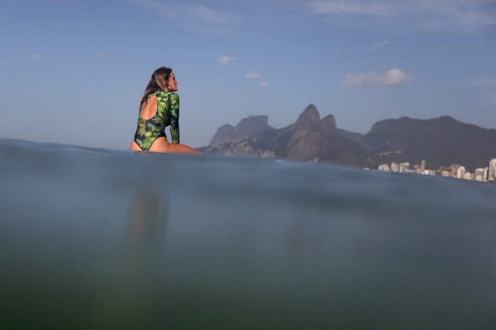 A surfer waits for waves at Ipanema beach in Rio de Janeiro