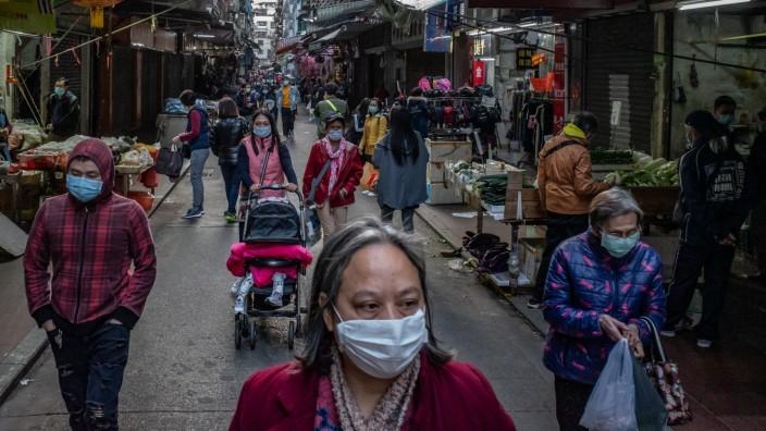 Menschen in Macau nach Ausbruch des Coronavirus