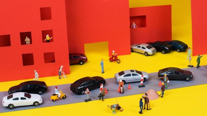 Illustration einer Straße mit Autos und Menschen