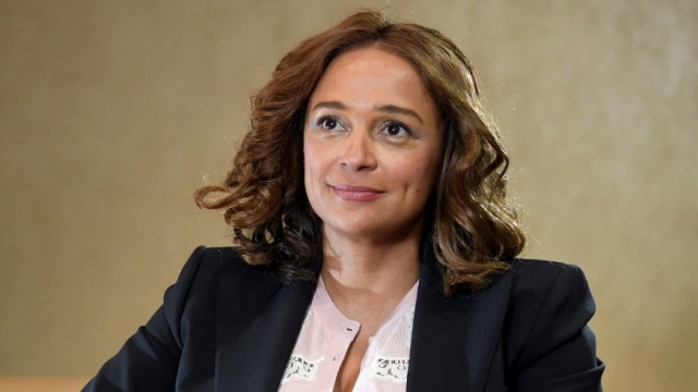 FILE PHOTO: Isabel Dos Santos, daughter of AngolaâÄÖs former President and Africa's richest woman, sits for a portrait during a Reuters interview in London, Britain