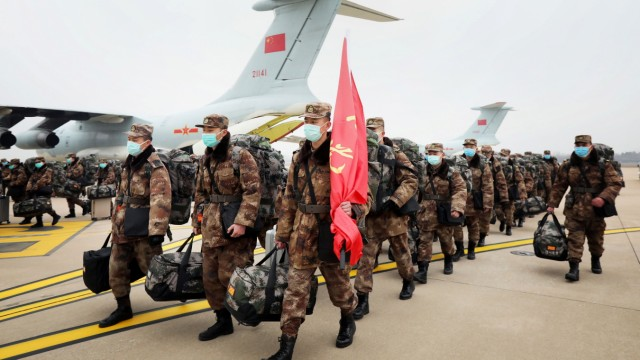 Chinese People's Liberation Army (PLA) Air Force aircraft arrive at the Wuhan Tianhe International Airport with medical personnel and supplies to help fight the outbreak of the new coronavirus in Wuhan