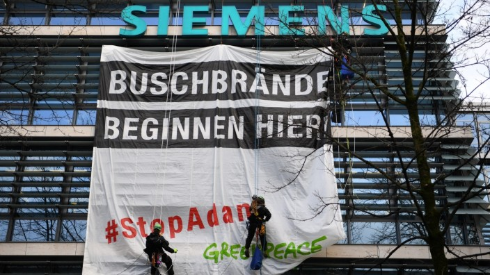 Greenpeace activists put up a banner reading 'Bush fires start here - stop Adani\