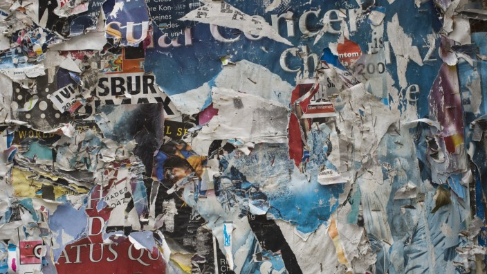 Germany Bavaria Regensburg torn posters on wall PUBLICATIONxINxGERxSUIxAUTxHUNxONLY CR002511
