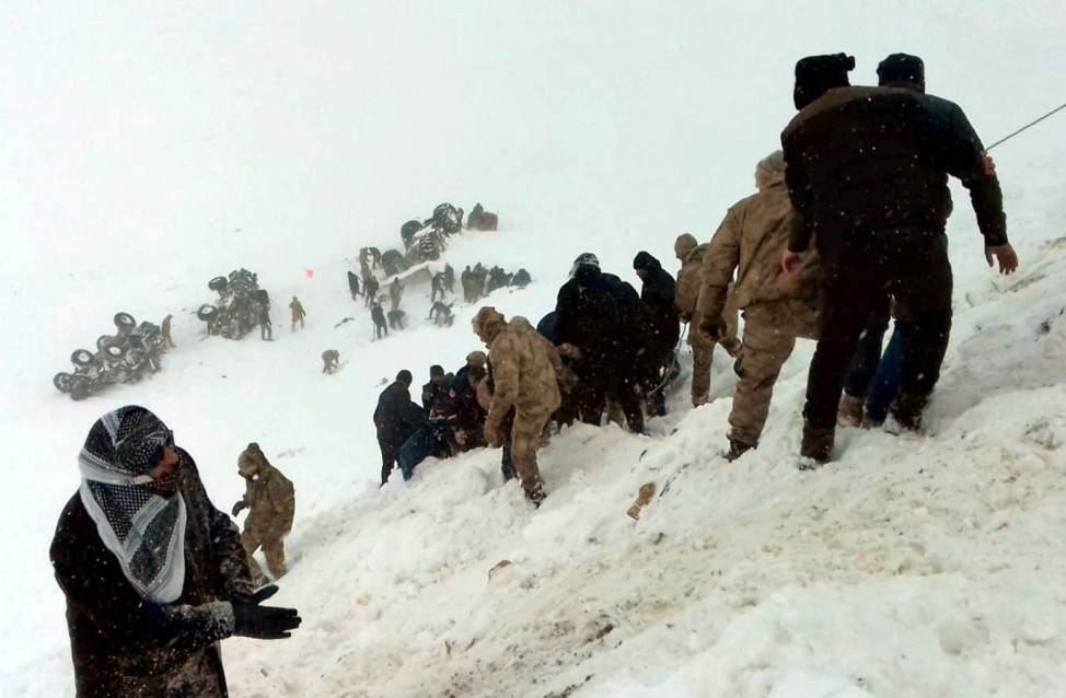 Turkish soldiers and locals try to rescue people trapped under avalanche in Bahcesaray in Van province