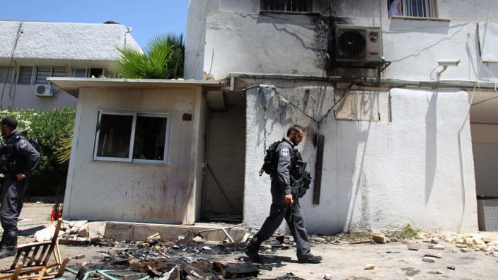170606 KAFR QASIM June 6 2017 An Israeli policeman walks past a damaged police station in