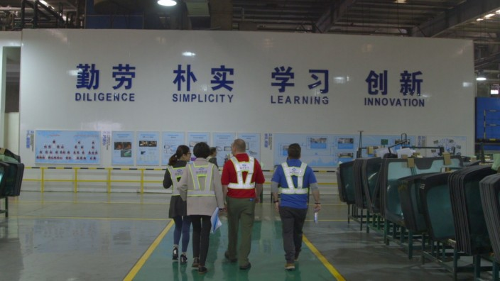 AMERICAN FACTORY, Management from Fuyao Glass America touring Fuyao in China...