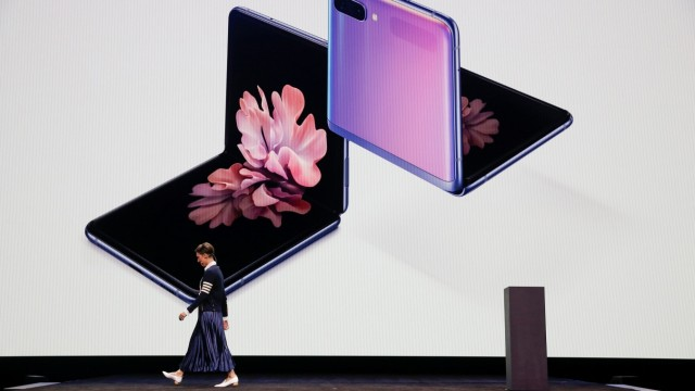 Rebecca Hirst of Samsung Electronics unveils the Z Flip foldable smartphone during Samsung Galaxy Unpacked 2020 in San Francisco