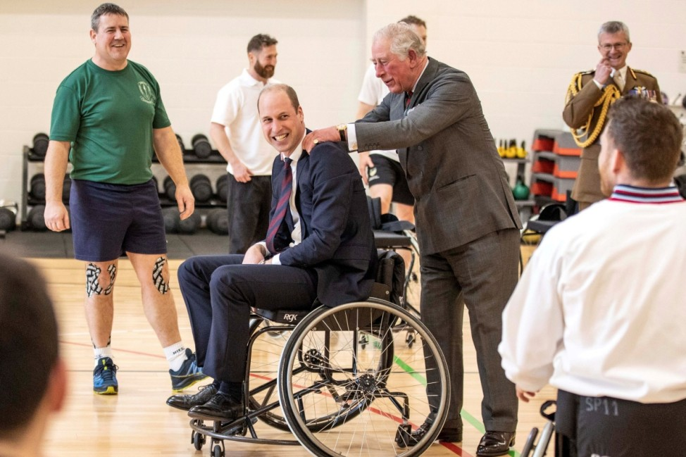 Britain's Prince Charles and Prince William are pictured during a visit to the Defence Medical Rehabilitation Centre (DMRC) in Nottinghamshire