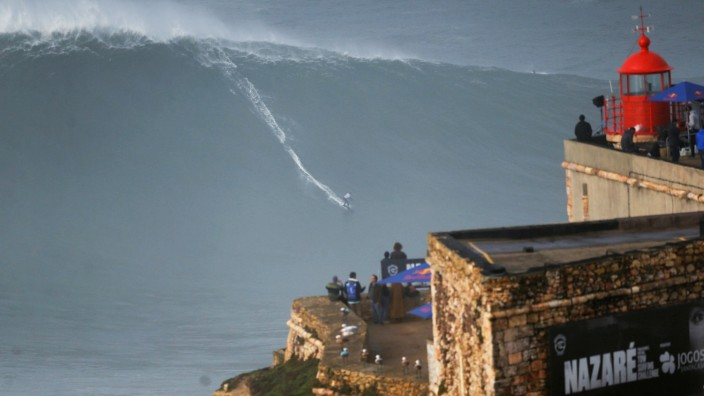 German surfer Sebastian Steudtner drops in on a large wave during Nazare Tow Challenge at Praia do Norte in Nazare