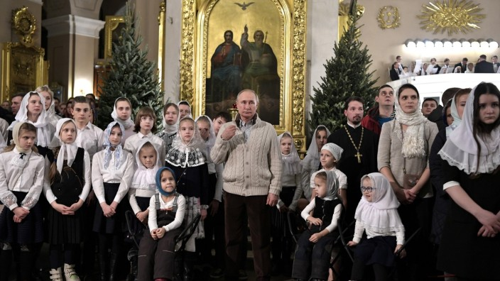 Russian President Putin attends the Orthodox Christmas service in Saint Petersburg