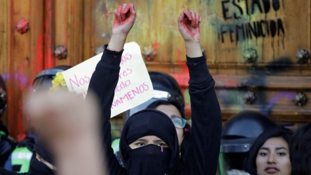 People take part in a protest against gender-based violence in downtown of Mexico City