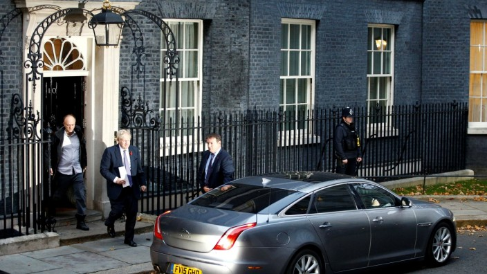 FILE PHOTO: Britain's Prime Minister Boris Johnson and Dominic Cummings, special adviser to Johnson, leave Downing Street to head for the Houses of Parliament in London