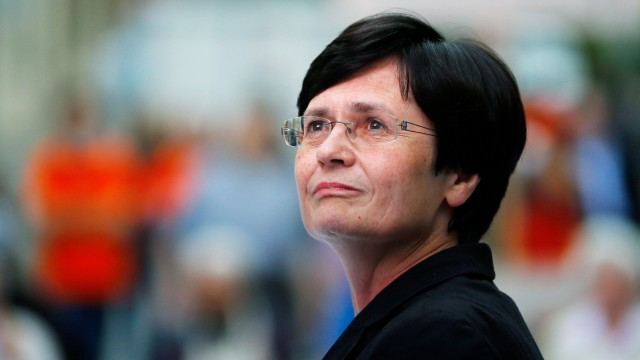 Lieberknecht, State PM of Thuringia and conservative Party top candidate, listens to questions during a Thuringia state election campaign rally in Altenburg
