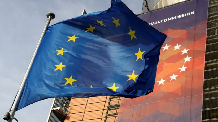 FILE PHOTO: A European Union flag flies outside the European Commission headquarters in Brussels