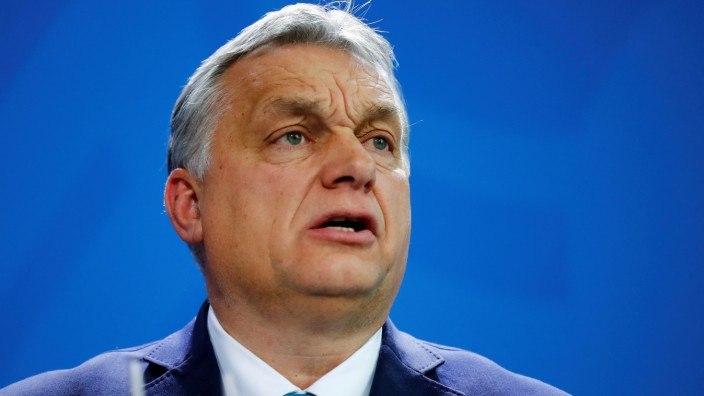 FILE PHOTO: Hungarian Prime Minister Orban speaks to media before talks with German Chancellor Merkel at Chancellery in Berlin