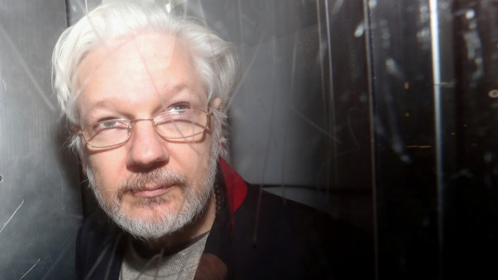 FILE PHOTO: WikiLeaks' founder Julian Assange leaves Westminster Magistrates Court in London