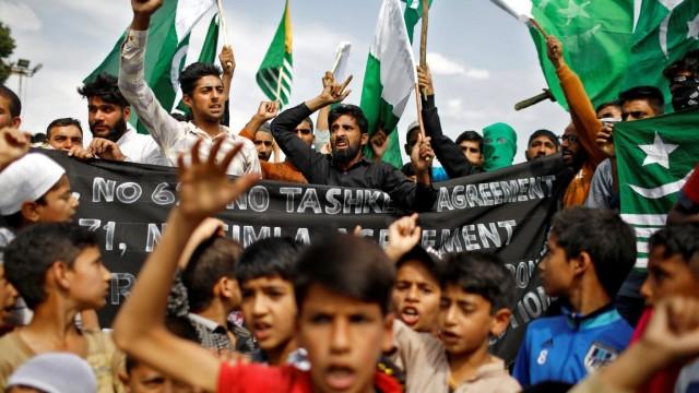 FILE PHOTO: Barricades and books in restive Kashmir neighbourhood