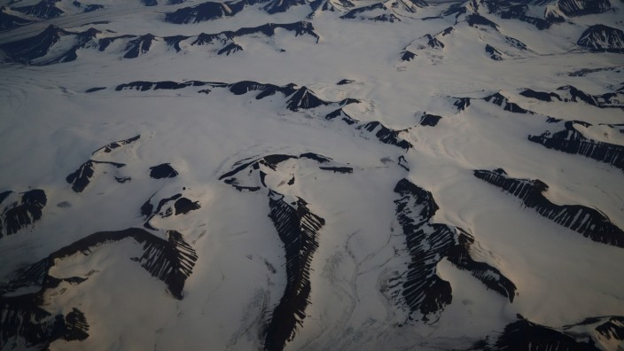 FILE PHOTO: An aerial view shows snow-covered mountains in Svalbard