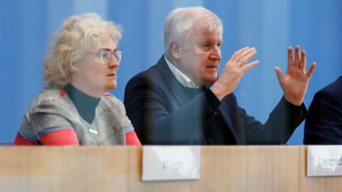 German Interior Minister Horst Seehofer and Justice Minister Christine Lambrecht address a news conference in Berlin