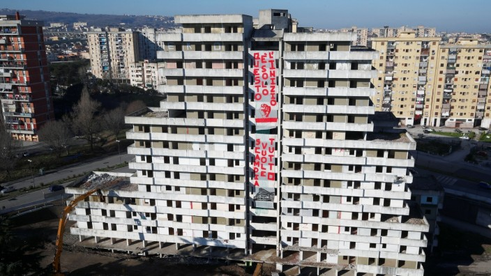 One of the so-called 'Sails of Scampia', a tower block known as a stronghold of Naples mafia, is demolished