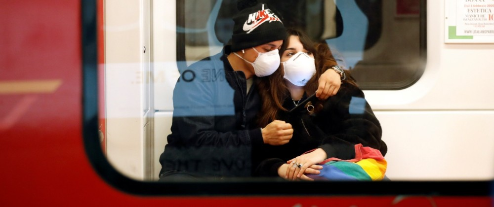 Couple wearing face masks is seen in the subway in Duomo underground station in Milan