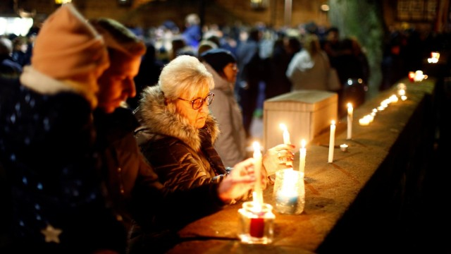 People attend a commemoration outside a church, the day after car ploughed into Carnival parade injuring several people in Volkmarsen
