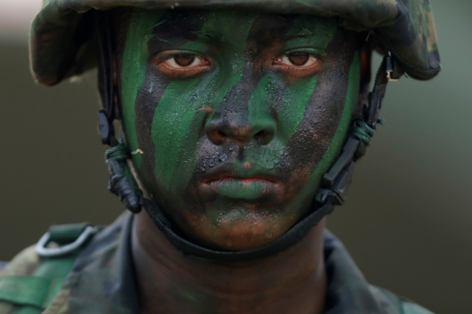 A soldier takes part in the Amphibious Assault Demonstration during the Cobra Gold multilateral military exercise in Hat Yao Beach, Sattahip District, Chonburi Province