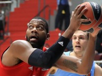 ST PETERSBURG, RUSSIA - FEBRUARY 27, 2020: FC Bayern Munich s Greg Monroe (L) and Zenit St Petersburg s Tim Abromaitis