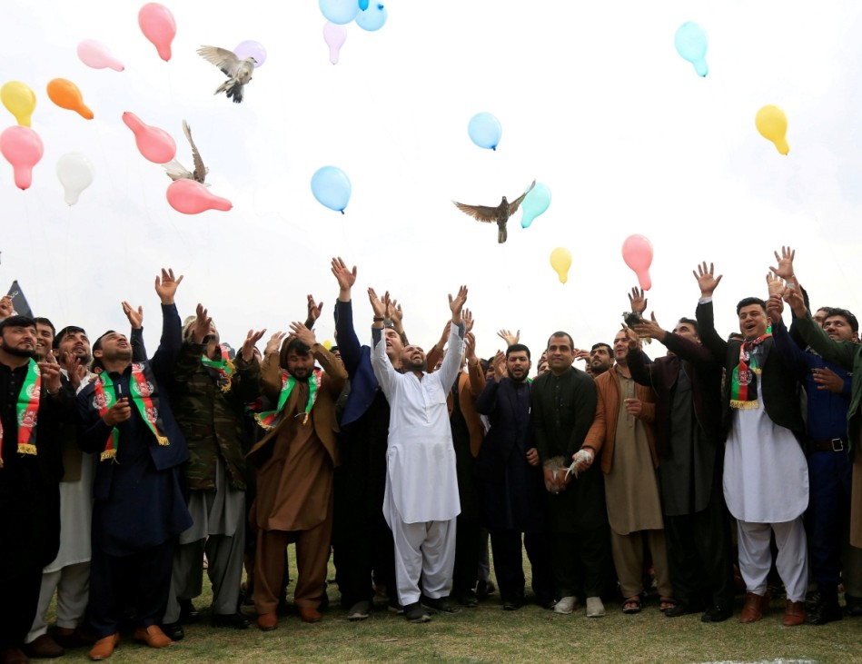 Afghan men celebrate in anticipation of the U.S-Taliban agreement to allow a U.S. troop reduction and a permanent ceasefire, in Jalalabad