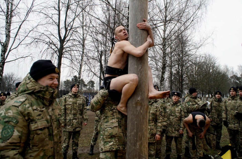 Servicemen of the Belarusian Interior Ministry's special forces unit show off their skills during celebrations of Maslenitsa, or Pancake Week, marking the end of winter