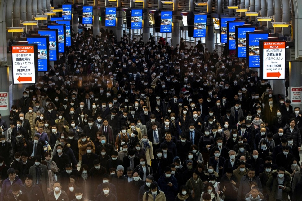 Crowds wearing protective masks, following an outbreak of the coronavirus, are seen at the Shinagawa station in Tokyo