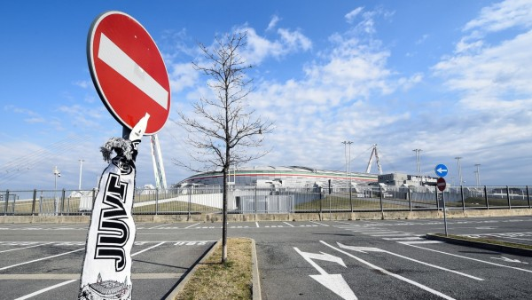 Juventus Football Club scarf is attached to a no entry sign outside the Allianz Stadium in Turin
