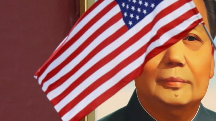FILE PHOTO: U.S. flag flutters in front of a portrait of late Chinese Chairman Mao at Tiananmen gate during the visit by U.S. President Trump to Beijing