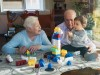 Great grandparents and baby girl playing together with plastic building bricks at home model release